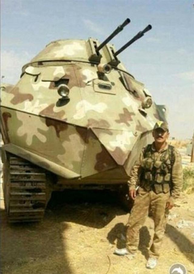 Xem xe bọc thép tự chế siêu dị của ISIS tại Iraq ảnh 2