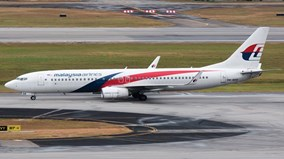 Động cơ bốc cháy, máy bay Malaysia Airlines hạ cánh khẩn cấp
