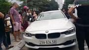 Bố đập vỡ ô tô BMW để cứu con gái mắc kẹt