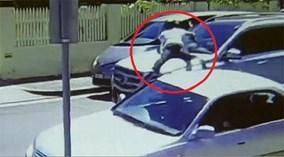 Clip 'nữ hiệp' phi thân lên nắp capo, ngăn kẻ cướp ôtô