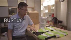 Quá nóng, dân Bắc Kinh tìm đến áo khoác điều hòa
