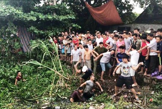 Clip hàng trăm người dân vây bắt 2 thanh niên nghi trộm chó-1