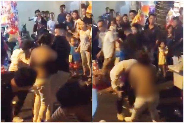 Xôn xao clip người phụ nữ bị lột sạch áo vẫn hùng hổ lao vào đánh nhau ở phố Hàng Mã đêm Trung thu - Ảnh 3.