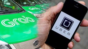 Bộ Giao thông yêu cầu xe Uber, Grab dán logo: Tài xế nói gì?