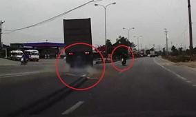 Xe máy sang đường kiểu tự sát, container lao sang làn đường ngược chiều