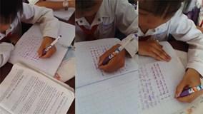 Cậu bé 9 tuổi dùng tay trái, xoay vở mọi hướng viết vẫn đẹp