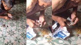 Cụ ông cất tiền kỹ nhất Việt Nam: Bọc chục lớp nilon, buộc trăm sợi thun