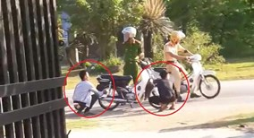 Không đội mũ bảo hiểm, 2 thanh niên bị CSGT phạt... xịt lốp xe