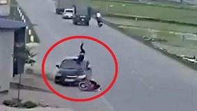 Người đàn ông sang đường bị hất tung lên ca pô