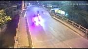 Phóng xe với tốc độ kinh hoàng tông người phụ nữ bay qua thành cầu