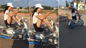 Cô gái 'cần tìm đối thủ' chạy xe bằng chân, tay bấm điện thoại gây sốt