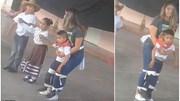 Cô giáo buộc chặt cậu bé vào người để tham gia nhảy cùng các bạn