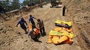 1 tuần sau sóng thần, Indonesia làm quen với việc đào hố chôn tập thể