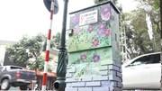 Hàng loạt tủ điện ở Hà Nội 'nở hoa' rực rỡ sắc mầu đón tết