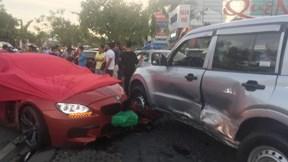 TP.HCM : Xe BMW 'điên' tông gãy cây xanh, đâm liên hoàn xe máy, ô tô