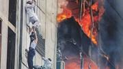Cháy cao ốc, nhiều người mạo hiểm bám dây cáp truyền hình để thoát thân