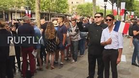 'NLĐ Kim Jong Un' vui vẻ ở Paris nhân ngày Quốc khánh Pháp