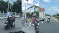 Thanh niên khoanh chân chữ ngũ, chạy xe máy 64km/h bằng một tay