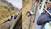 Bám tàu đang chạy bị rơi xuống đường ray, nam thanh niên may mắn thoát chết