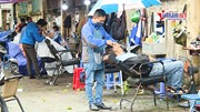 Mở cửa sau cách ly, phố tóc Hà Nội 'vắt chân lên cổ' phục vụ khách