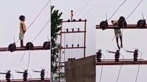Bé trai 5 tuổi leo cột điện cao chót vót để 'ngắm cảnh'