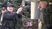 TT Belarus mặc áo chống đạn, cầm súng, bay trên biển người biểu tình