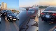 Mặc biển cấm, 'xe hợp đồng' hồn nhiên dừng trên cầu Long Biên