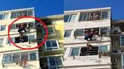 Người hàng xóm dũng cảm đỡ cậu bé bị treo trên giàn phơi đồ ngoài ban công