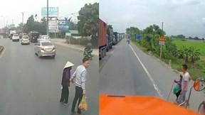 Chậm vài phút dắt cụ bà sang đường, tài xế container nhận 'mưa tim'
