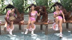 Đười ươi tạo dáng gây sốc khi chụp ảnh với cô gái xinh đẹp