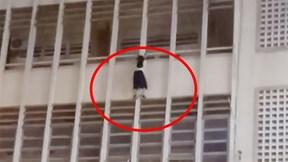 Nữ sinh cấp 2 lơ lửng trên lan can tầng 3 thoát chết trong gang tấc