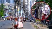 """Nhanh chóng nhổ, di dời 80 cột điện """"chễm chệ"""" giữa đường ở TP.HCM"""