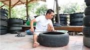 Anh nông dân 'hô biến' hàng trăm lốp xe cũ thành chậu kiểng độc đáo