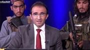 """Dẫn chương trình người Afghanistan """"lên sóng"""", Taliban cầm súng đứng sau"""