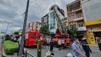 Nhà cao tầng bốc cháy dữ dội, 1 người trượt chân từ tầng 4 bị thương